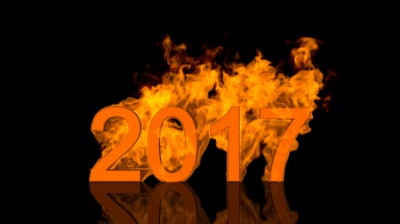 Dynamic 2017 New Year date design with fiery numerals engulfed in bright orange flames over a black background with copyspace for your seasonal greeting above