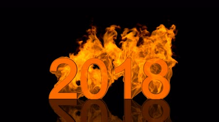 Dynamic 2018 New Year date design with fiery numerals engulfed in bright orange flames over a black background with copyspace for your seasonal greeting above