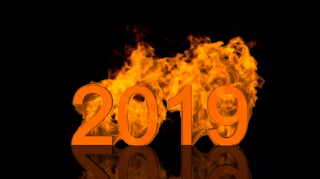 Dynamic 2019 New Year date design with fiery numerals engulfed in bright orange flames over a black background with copyspace for your seasonal greeting above