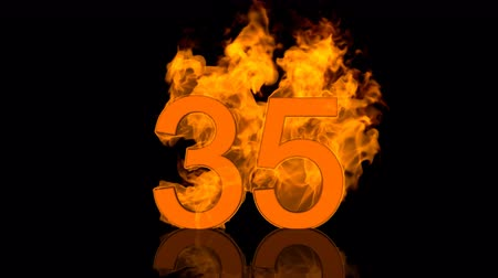 otuzlu yıllar : Flaming Number Thirty Five Burning in Orange Fire Stok Video