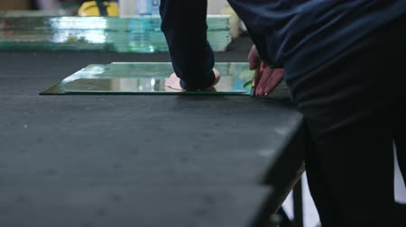 pane : Cutting glass process. Men in gloves cutting glass. Close-up shot Stock Footage