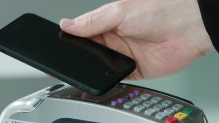 card pin : Mobile payment with a smartphone, online shopping concept. Close-up shot