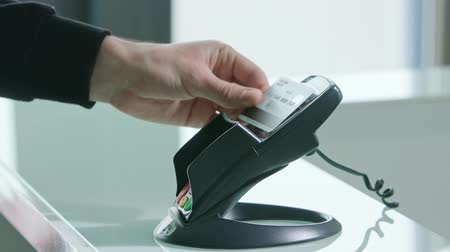 card pin : Mobile payment with a credit card, online shopping concept. Close-up shot