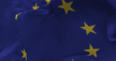 unie : Close up Europe Union flag blowing in the wind, looped slowmotion, 4K