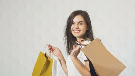 tshirt : Portrait of happy shopper, smiling beautiful girl holding shopping bags of various colors
