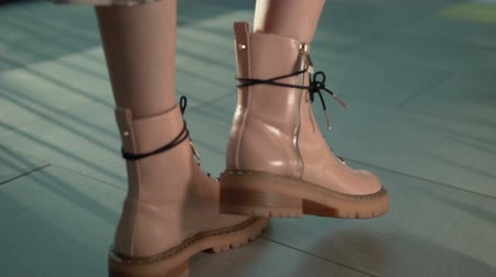 blúz : Stylish girl wears fashionable pink boots walks against sunset, slowmotion