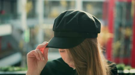 goma : Stylish long hair girl wears black hat, indoor slowmotion