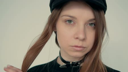 goma : Closeup of stylish long hair girl wears black hat, indoor slowmotion Stock Footage