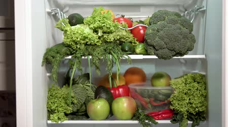 pırasa : Closeup of full fridge, fresh and colorful vegetables in the refrigerator, rich nutrition food Stok Video