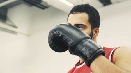 gömleksiz : Bearded handsome man wears red shirt and black gloves have boxing training, slowmotion, motivation concept