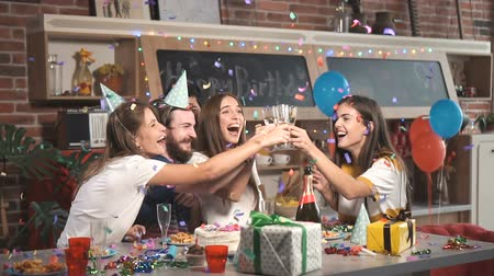 лифтинг : Group of joyful friends lifting the glasses as confetti showering down, concept of great and amazing celebration excitement Стоковые видеозаписи