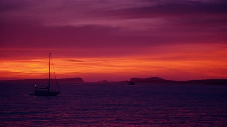 baleár : Sunset afterglow at the sea with sailing ships