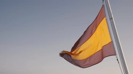 baleár : Spanish flag waving in the wind at the sea