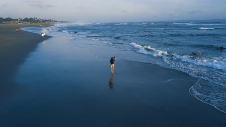 girl running on the beach Stock Footage
