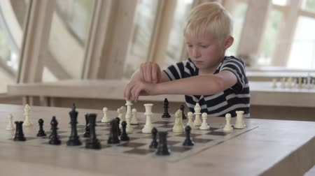 delikanlı : The boy plays chess. The child makes the move an officer. The boy plays with white pieces.