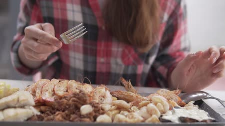 meze : Woman eating seafood in a cafe. Close-up of a plate of food. Slow motion Stock Footage