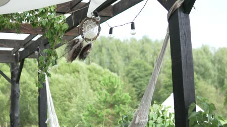 native american culture : Dreamcatcher sways in the wind on the veranda in summer. Stock Footage