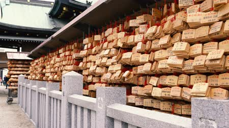 handrails : Osaka, Japan-April 15, 2018: a wall full of little wooden boards hanging on it, its a praying wall