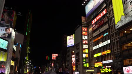 osaka : Osaka, Japan-April 15, 2018: famous shopping area in Japan, every stores is opening at night Stock Footage