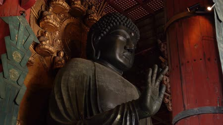 historia : Buddha statue with curly hair and having a dot in the middle of forehead