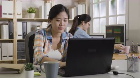 第2 : fast forward of young office ladies working in bright cozy place in daytime. girl worker drinking tea hot coffee and keep writing on notebook. elegant coworker using calculator typing on laptop.