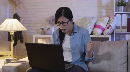ficando : slow motion annoyed girl in glasses shut down laptop. mad businesswoman sitting in sofa looking at laptop screen with angry expression. Too much workload file error data failed forgot save document Stock Footage