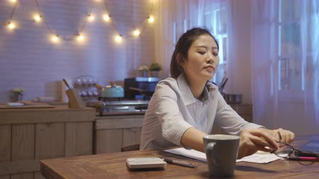 tablo : woman back home from work and exhausted sleep on kitchen table at night