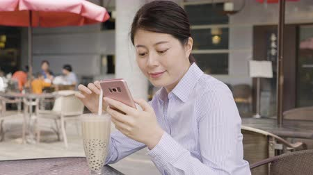 tapioca : slow motion asian business woman in shirt drinking bubbles milk tea by straw in asia taiwan. Stock Footage