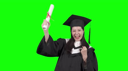 igen : education gesture and people concept. happy asian woman college university student in mortar board and bachelor gown with diploma celebrating successful graduation showing smiling cheerful chroma key