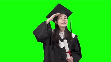 bizakodó : new fresh graduate female find search job career with hand gesture. young asian chinese college girl looking forward future with hopeful heart holding diploma and wearing gowns caps green background
