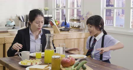 go to school : slow motion of young elegant asian woman business worker people in suit realize time to leave in morning. parent and kid in a rush going to school and work company take away breakfast toast bread.