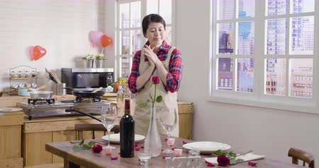elegant girl in apron prepare for valentines day romantic dinner at home.
