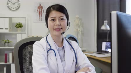 Medical nurse doctor woman wear headset and stethoscope in hospital office.