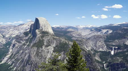 Half Dome with view of Vernal Fall and Nevada Falls Mist Trail from Glacier Point in summer Yosemite National Park California USA.