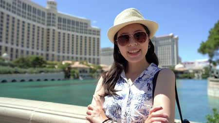 smiling tourist woman having fun in hot summer day in las vegas america.