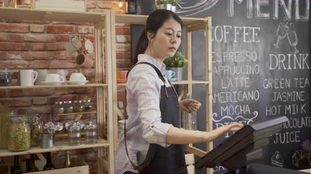 woman barista in coffee shop ready to work in the morning.