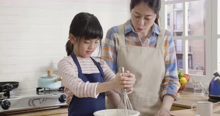cute little daughter wants make a cake for mom for celebrating mother day.