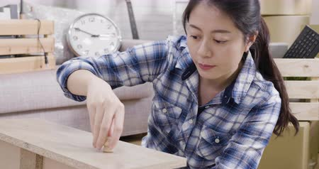 asian elegant woman relocation diy furniture in house.
