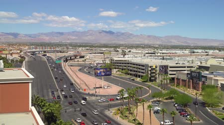 LAS VEGAS, USA - MAY 28, 2018 : roads of Las Vegas cityscape in morning after sunrise. cars driving fast on highway in nevada us. beautiful urban view with clear sunny blue sky on summer season. Vídeos