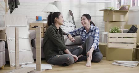 DIY concept. slow motion two young asian women repairing furniture in living room at home. Vídeos