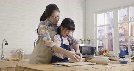 asian chinese mom and daughter preparing homemade cookies bread for happy mothers day. Vídeos