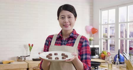 üreten : beautiful housewife prepared surprised dessert candies on valentines day. Stok Video