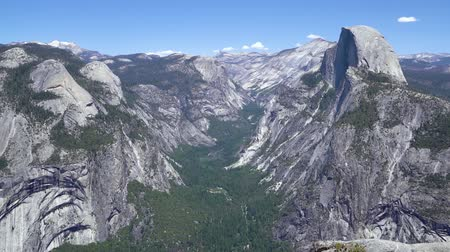 View of Half Dome behind granite walls in Yosemite National Park california usa.