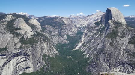 beautiful summer view of Yosemite valley with half dome mountain bridalveil waterfall seen from Tunnel view vista point at Yosemite National Park California USA.