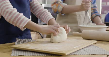 slow motion close up on hands parent and kids diy together in house kitchen prepare cake for happy mothers day.