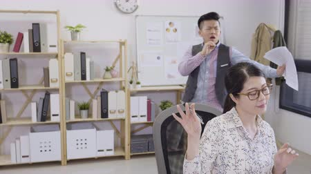 Two young fun asian male and female office colleagues dancing together in company while working. Wideo