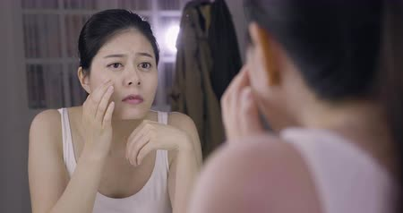 vanity : slow movement of sad lady celebrity checking skin before applying make up in backstage dressing room. Stock Footage