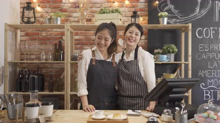 ski : two young asian women coworker working at cafe bar face camera and smiling attractive. Wideo