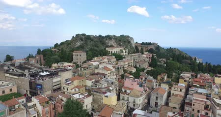 szicília : Aerial shot of the Taormina, small town on the east coast of the island of Sicily, Italy Stock mozgókép