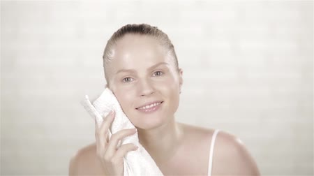 arc : Spa beauty treatment woman smiling happy feeling soft towel on face